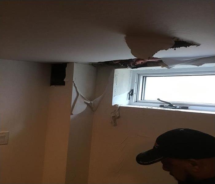 pipe burst causing damage to ceiling and walls