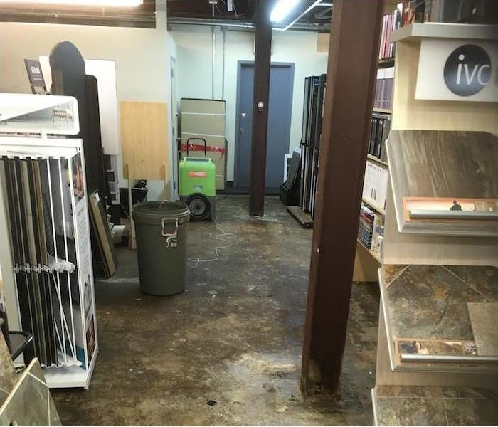 Flooring company with industrial carpet removed and dehumidifier running
