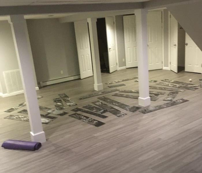 Wood floor with removed flooring upside down on it