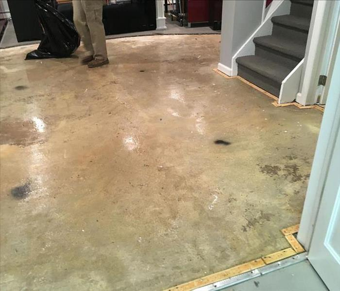 SERVPRO tech standing on a concrete floor