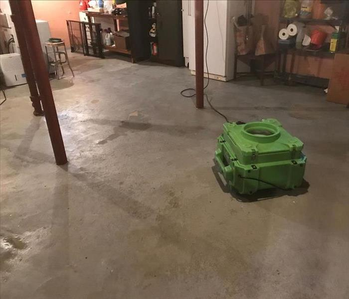 Basement with various items and SERVPRO equipment