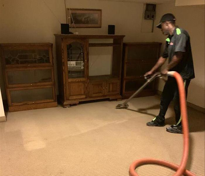 technician applying the finishing pass over after cleanup of the carpet