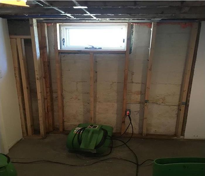 exposed wall allowing equipment to dry water damage area