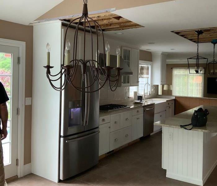 Kitchen with cut out ceiling portions
