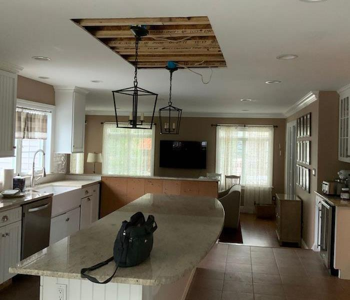 Kitchen with hole in the ceiling
