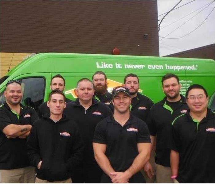 production crew photo in front of green van