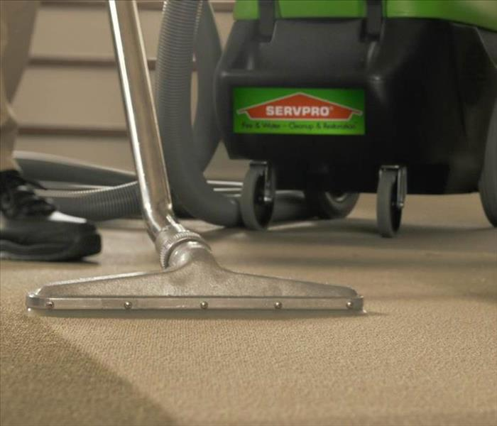 SERVPRO tech cleaning carpet