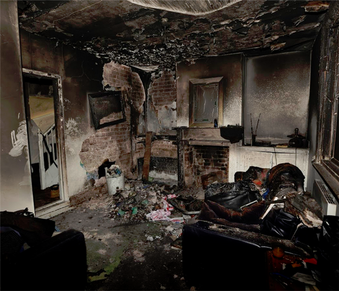 fire damaged living room with burned items everywhere