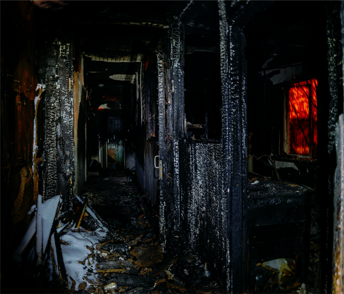 fire damaged hallway with soot covering the walls