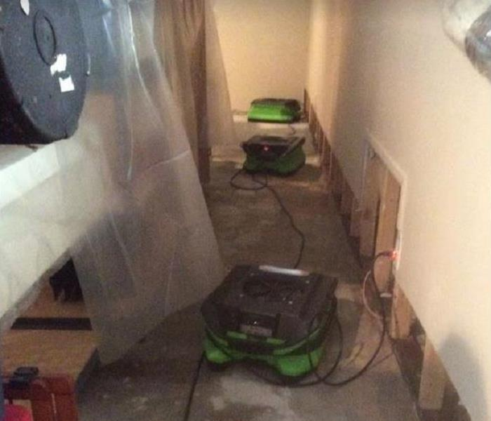 SERVPRO equipment drying water damaged floor and room